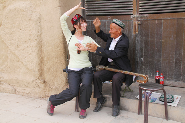 Satomi learning some folk dance techniques from a local elder at the Bezeklik Grottoes - Journey from the West, 2014/10