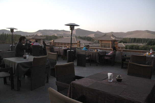 Our hotel in Dunhuang had a patio on the roof – the perfect spot to see the sun rise over the dunes before breakfast - Journey from the West, 2014/10