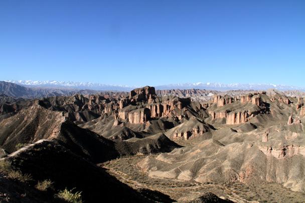 A view of the Binggou Rock landform, with the Qilian Mountains in the background - Zhangye Danxia Landform, Gansu Province, 2014/10