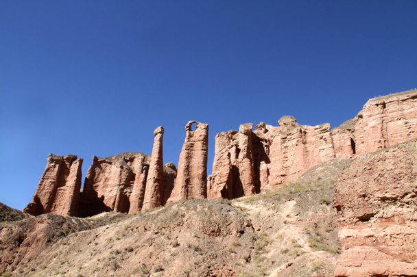 A view from below of an arch in one of the pillars - Zhangye Danxia Landform, Gansu Province, 2014/10