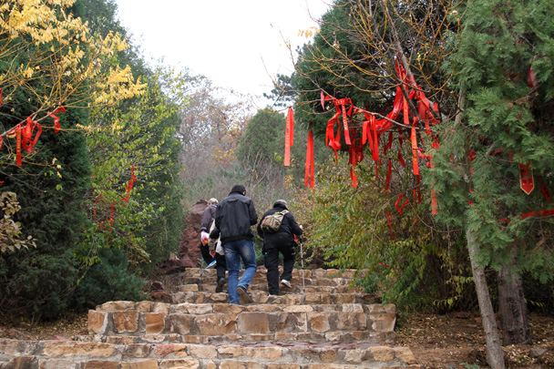 The red ribbons beside the trails are marked with Taoist blessings - Yajishan Taoist Temples hike, 2014/10