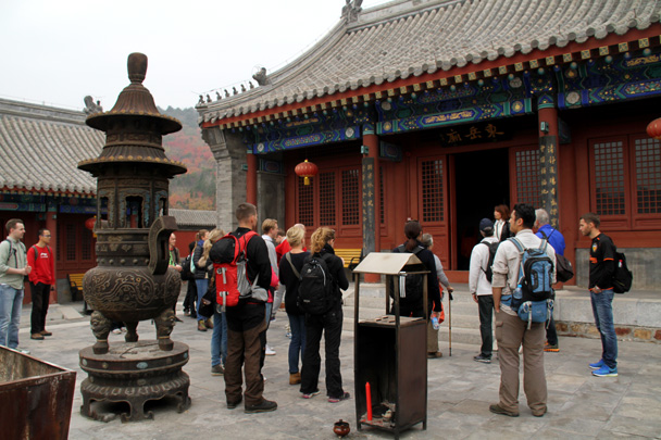 Ying is talking more about the temple - Yajishan Taoist Temples hike, 2014/10