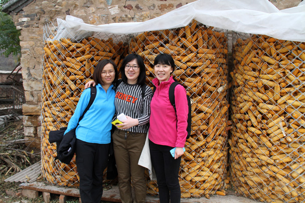 Photo time in front of the corn storage area. A lot of corn is grown to feed to pigs - Yajishan Taoist Temples hike, 2014/10