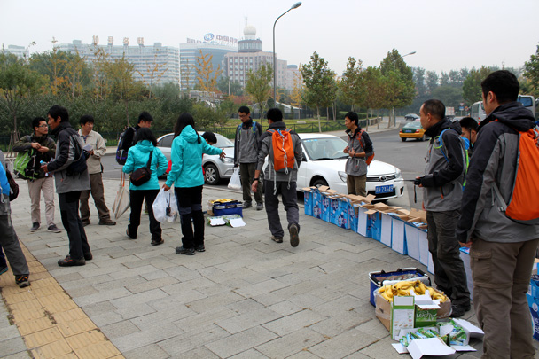 Hiking guides handing out snacks and drinks at the departure point - CNCC teambuilding hike at the Little West Lake, 2014/10