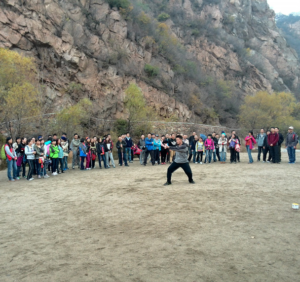 One of the taichi instructors demonstrated a taichi routine - CNCC teambuilding hike at the Little West Lake, 2014/10