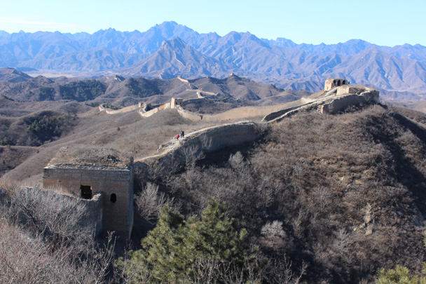 17 After climbing up to the highest tower in the area we backtracked a little bit to get to the end of the hike. In this photo you can see all the way back to where we started the hike, atop the hills in the middle distance - Gubeikou Great Wall hike, 2015/02/08