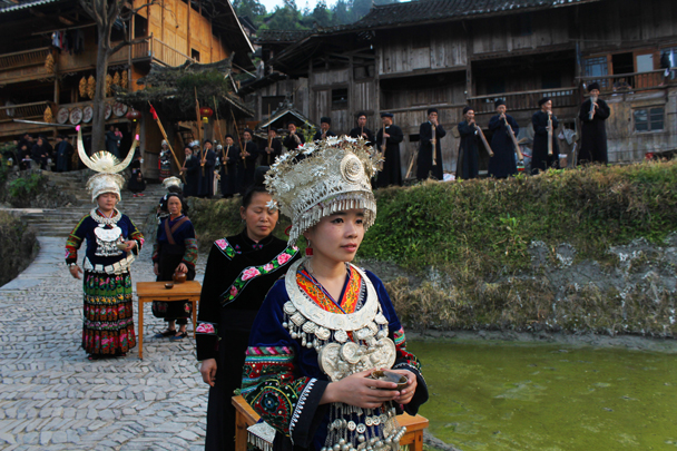 Young women dressed up to welcome us - Miao and Dong culture in Guizhou, 2015/04