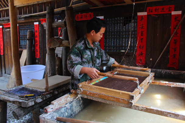 The next step of the paper-making process: pressing the water out of the pulp - Miao and Dong culture in Guizhou, 2015/04