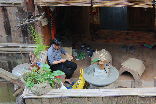 A quiet moment of knitting at the balcony - Miao and Dong culture in Guizhou, 2015/04