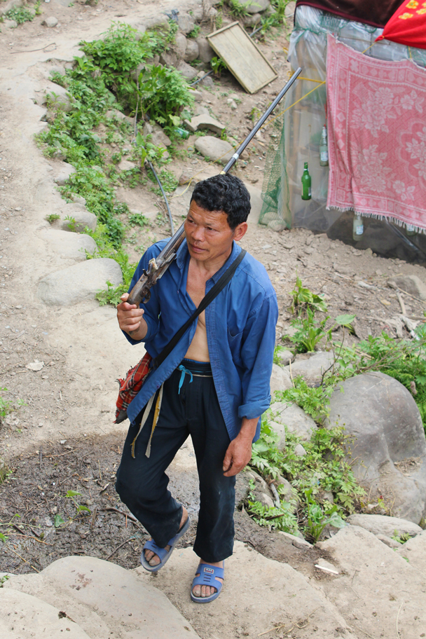 A hunter on his way home - Miao and Dong culture in Guizhou, 2015/04