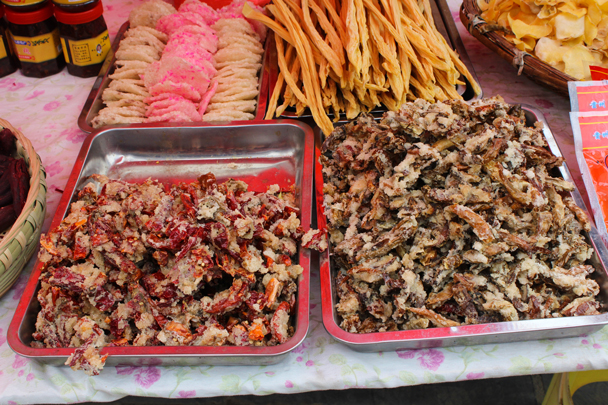 Fried chilli peppers and fried rice cakes, popular local snacks - Miao and Dong culture in Guizhou, 2015/04