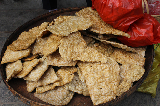 Deep-fried tofu ready to eat - Miao and Dong culture in Guizhou, 2015/04