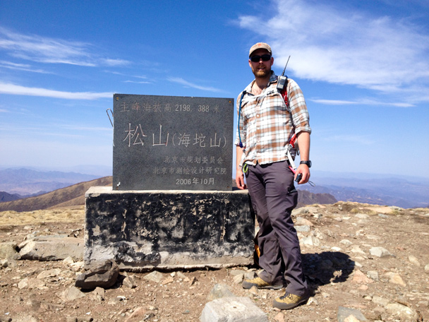 Hiking guide Simon at the top. We said the peak was 2198.388m, and the sign here is our proof! - Dahaituo Mountain hike, 2015/04/25