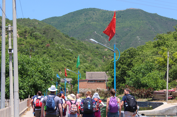 The group setting off through Moyashike village, with our destination seen on the far skyline - Great Wall Spur Camping, 2015/05