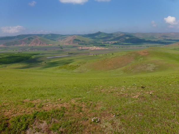 Rolling hills, with small villages in the valleys - Bashang Grasslands, Hebei Province, 2015/06