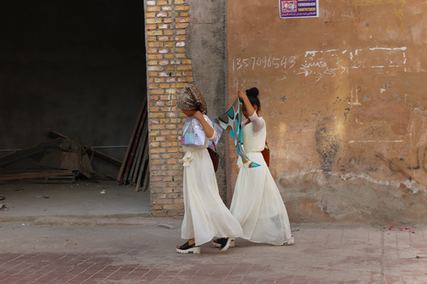 Covered hair is the local tradition for girls - Along the Silk Road from Korla to Kashgar, 2015/06