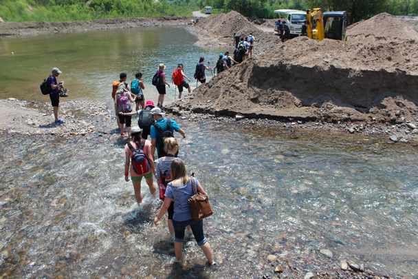 The fellows here have dug a channel in the road, planning to build a bridge with which they can extract a toll of passersby. Cheeky! - White River hike, 2015/07/05