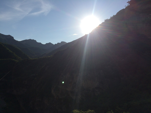 The sun is about to disappear behind the hills - Ming Village overnight, 2015/08