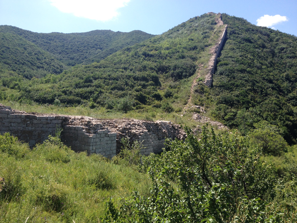 The foundation of a large tower. Hidden by the leaves and grass is a large archway through which water used to flow. This is the Shuitou Great Wall, 'Shuitou' roughly meaning 'Water Head' - Shuitou Village Loop hike, 2015/08/22
