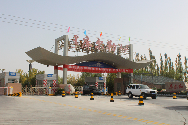 Our jeeps coming through the toll gate, ready to get started on the Silk Road - Along the Silk Road from Korla to Kashgar, 2015/09