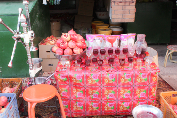 Fresh-pressed pomegranate juice for sale - Along the Silk Road from Korla to Kashgar, 2015/09