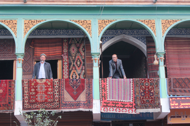 Men, balconies, carpets, in Kashgar - Along the Silk Road from Korla to Kashgar, 2015/09