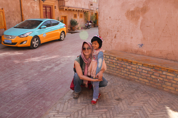 Photo with a youngster - Along the Silk Road from Korla to Kashgar, 2015/09