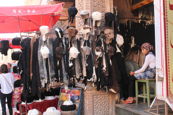 Hats for sale - Along the Silk Road from Korla to Kashgar, 2015/09