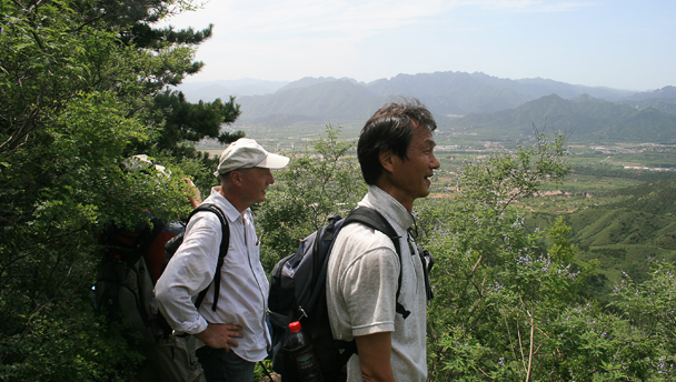 Hikers on a path through the trees in Changping District