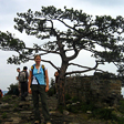 A hiker and the famous pine tree, near the highest point of the Chinese Knot