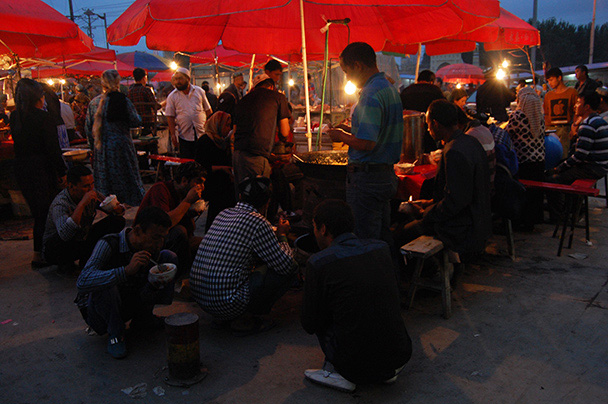 The night market market in Kashgar's old town is famous for the food – some stalls so popular you can't get a seat,Beijing Hikers Kashgar and Lake Karakul trip 2013/08/20