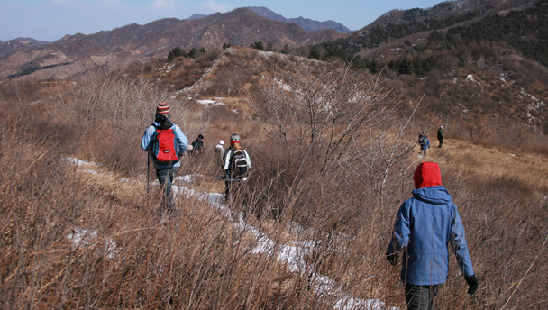 Hikers on a trail through the hills above Sancha Village