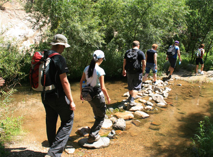 People crossing stepping stones, Beijing Hikers Two Valleys hike, 2009-08-24